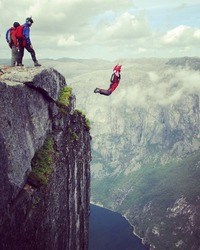 Freedom, flight. BASE Jumping from Kjeragbolten rock in Rogaland, Norway.