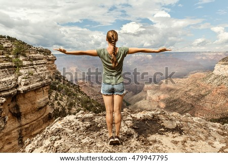 Freedom Girl with hands up on top of the Mountain at Grand Canyon National Park, Arizona