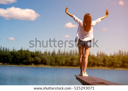freedom happy Woman Enjoying Nature. Beauty Girl Outdoor. lifestyle concept. Beauty Girl over Sky and Sun. Enjoyment. #525293071