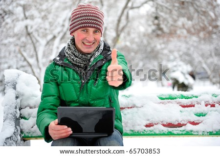 Freedom - Man using a laptop outdoor in winter park with copyspace