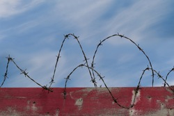 Freedom motivational inspiring quote and landscape with barbed wire fence background. Concept of refugees, immigration and restrictions