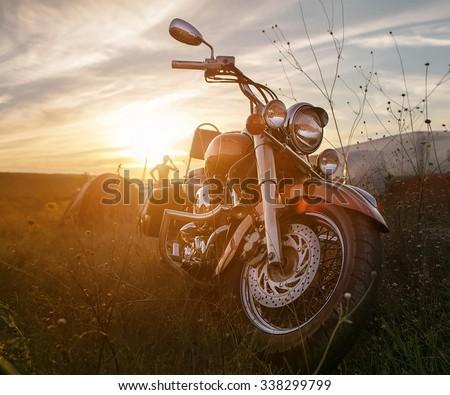 Freedom.Motorbike under sky.Vintage photo effect added for create atmosphere
