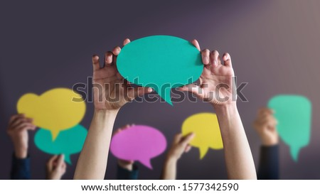 Freedom of Speech Concept. Group of People Protesting or making Campaign with a Blank Speech Bubble. Expression for the Human Rights Foto stock ©