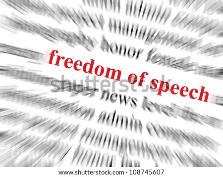 Freedom of speech text in red and in focus. Surrounding text out of focus with zoom effect.