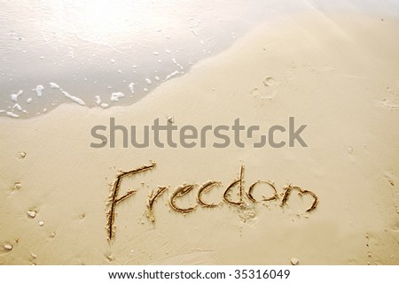freedom written in sand beach