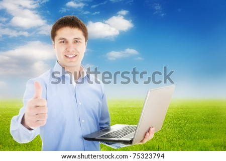 Freedom -Young happy man with laptop in nature