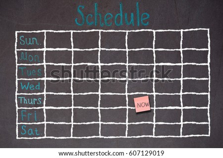 Freehand white chalk doodle sketch of blank monthly grid timetable schedule on black chalkboard background: Hand drawn study plan on blackboard with weekly date written in colorful pastel color