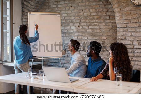 Freelance business people with board having discussion