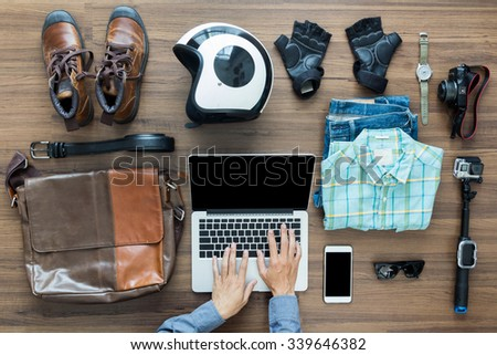 Freelancer needs mock up on wooden table in home interior, laptop computer, hipster clothes and accessories electronic business and distance work concept, View from above top view with copy workspace