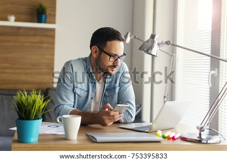 Photo of Freelancer working from home and using phone