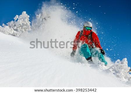 Freeride in fresh powder snow. Skiing. #398253442