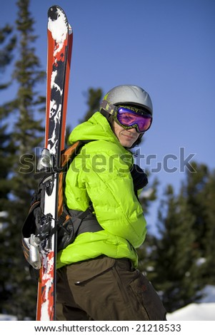 Freeride skier with skis on the backpack