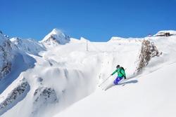 Freeride skiier in the mountains