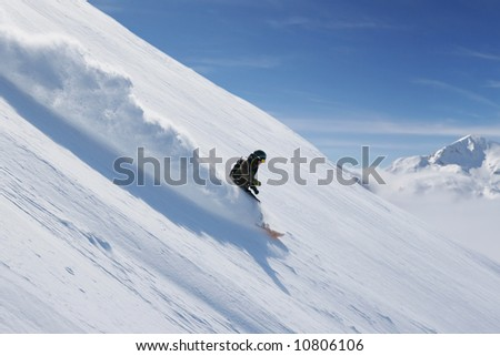 Freeride snowboarding at Vogel ski resort, Slovenia.