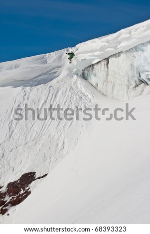 Freerider jumping from a steep