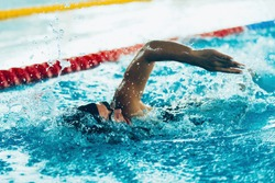 Freestyle swimming competitor in action
