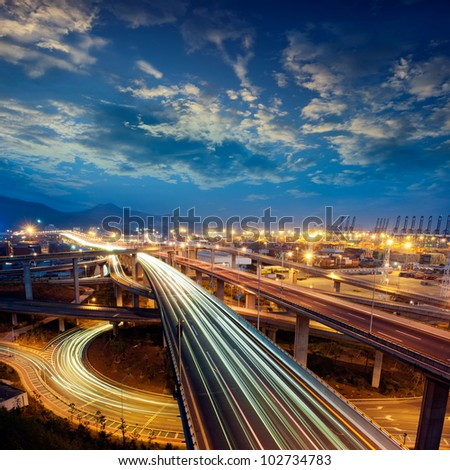 Freeway in night with cars light in modern city