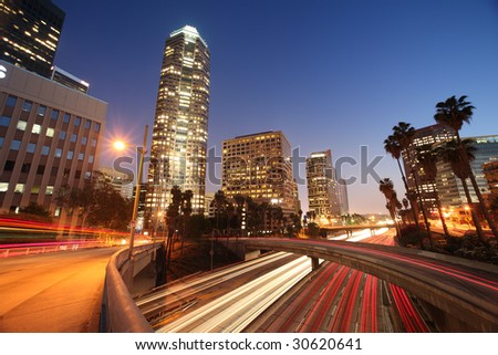 Freeway traffic in downtown Los Angeles at night. - stock photo