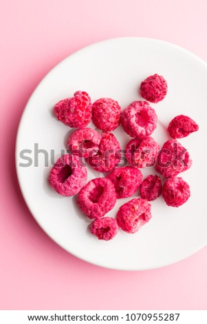 Freeze dried raspberries on plate.