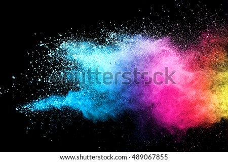 Freeze motion of blue and pink color powder exploding on black background.