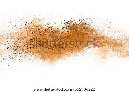 Freeze motion of brown color powder exploding on white background. #562906222