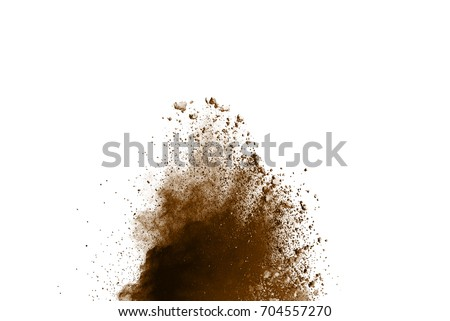 Freeze motion of brown dust explosion on white background. Stopping the movement of brown powder on white background. Explosive powder brown on white background. Dry soil explosion on white background