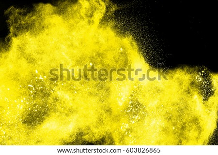 Freeze motion of colorful  painted powder exploding  on dark background. Abstract design of color dust cloud. Particles explosion. Splash of colorful painted powder on black background. #603826865