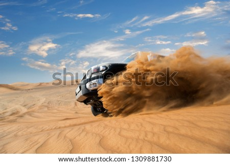 Freeze motion of four wheel drive through the desert in the United Arab Emirates. Stock photo ©