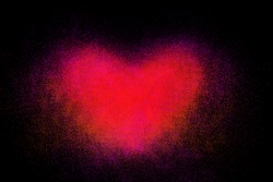 Freeze motion of heart shaped red powder isolated on black, dark background. Abstract design of dust cloud. Particles explosion screen saver, wallpaper with copy space. Love, passion, feelings concept