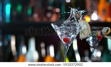 Freeze motion of splashing martini drink in bar. Free space for text