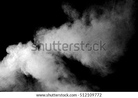 Freeze motion of white dust explosion on black background. Stopping the movement of white powder on dark background. #512109772