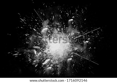 Freeze motion of white paint powder exploding, isolated on black, dark background. Abstract design of white dust cloud. Particles explosion screen saver, wallpaper copy space. Planet creation concept Foto stock ©