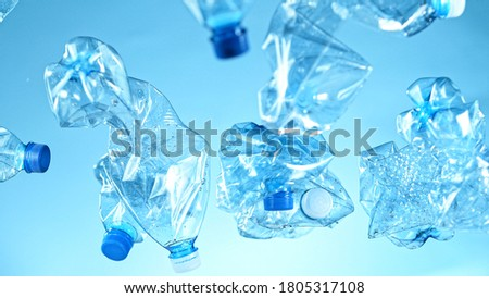 Freeze Motion Shot of Flying Plastic Waste on Blue Gradient Background ストックフォト ©