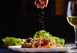 Freezer food prepare in process vegetarian salad by chef hand in home kitchen. Dark black background with Text area for design menu restaurant