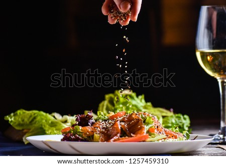 Freezer food prepare in process vegetarian salad by chef hand in home kitchen. Dark black background with Text area for design menu restaurant Stok fotoğraf ©