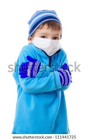 Freezing boy in winter clothes and medical mask, isolated on white