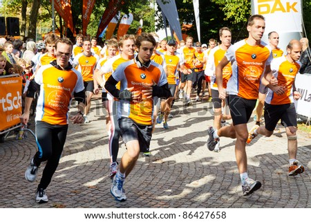 FREIBURG, GERMANY - OCT 9: Runners at the starting line of the Stadtlauf Freiburg Half Marathon on October 9, 2011 in Freiburg, Germany. The event is sponsored by SportScheck and BMW.