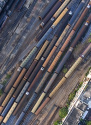 Freight and passenger train waiting at the train station parking lot.Cargo transit.import export and business logistic.Aerial view.industrial railway landscape. transportation.Thailand.