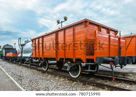 Freight car of the railway. An old wagon for the carriage of goods. Railway car of wood. #780715990