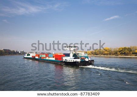 Freight ship on Rhine River, Germany, Bonn in background