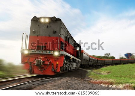 Freight train locomotive carrying with cargo on daylight