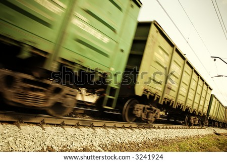 freight  train (special toned and blur-motion photo f/x, focus point on railroad embankment and rail)
