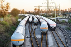 Freight train with petroleum tank-cars . terminal of freight cars . Transportation of liquid and dangerous goods by rail