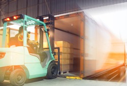 Freight transportation and Logistic warehouse, Forklift driver loading the shipment pallet into a truck container.