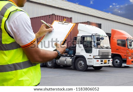 Freight transportation. warehouse worker are holding clipboard with control loading a trucks. #1183806052
