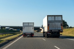 Freight trucks on a highway. Concept of safe driving.