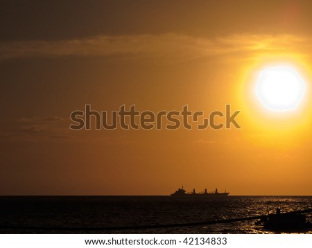 Freighter at sunset Coral Sea Australia
