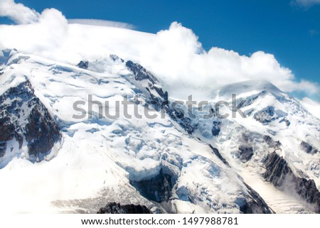 French Alp mountains covered in fresh white snow. Mountaineering, travelling, active life concept.  #1497988781