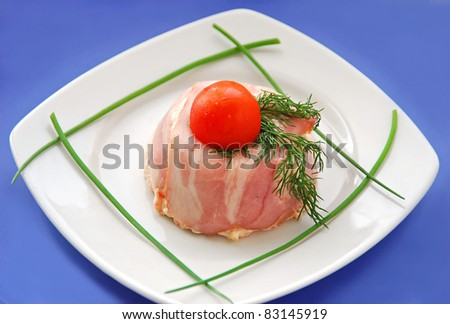 French appetizer - pate, terrine with bacon and cream on blue background