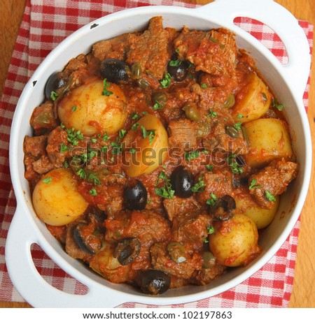 French beef stew with new potatoes, olives and capers.